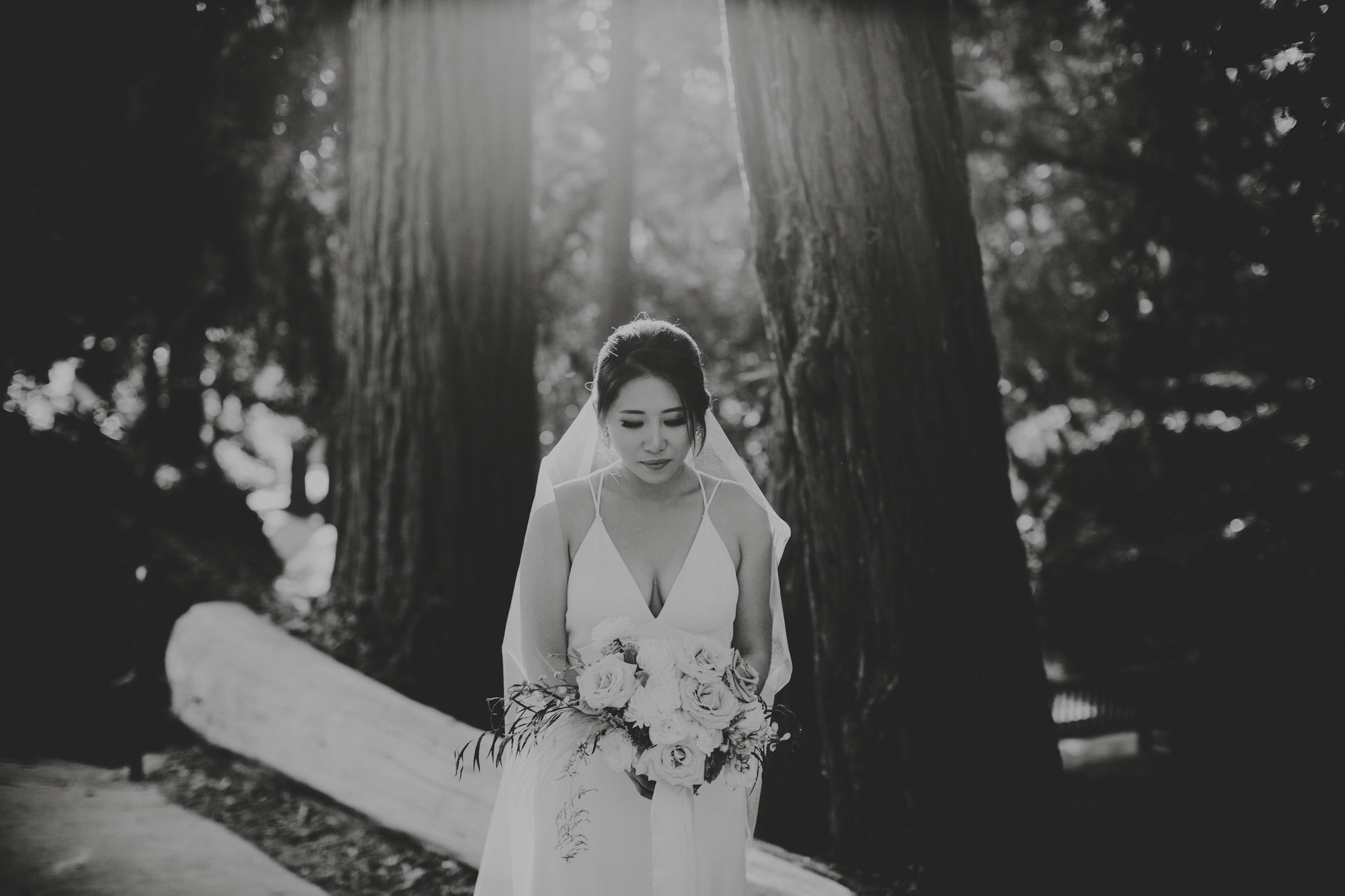 bride in black and white holding her flowers